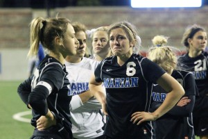 Freshman Laurel Edwards (6) and the rest of the Marian team look on as the Wildcats celebrate. Marian won the state championship last year against Millard North, 1-0. Photo by Corey Hadfield.