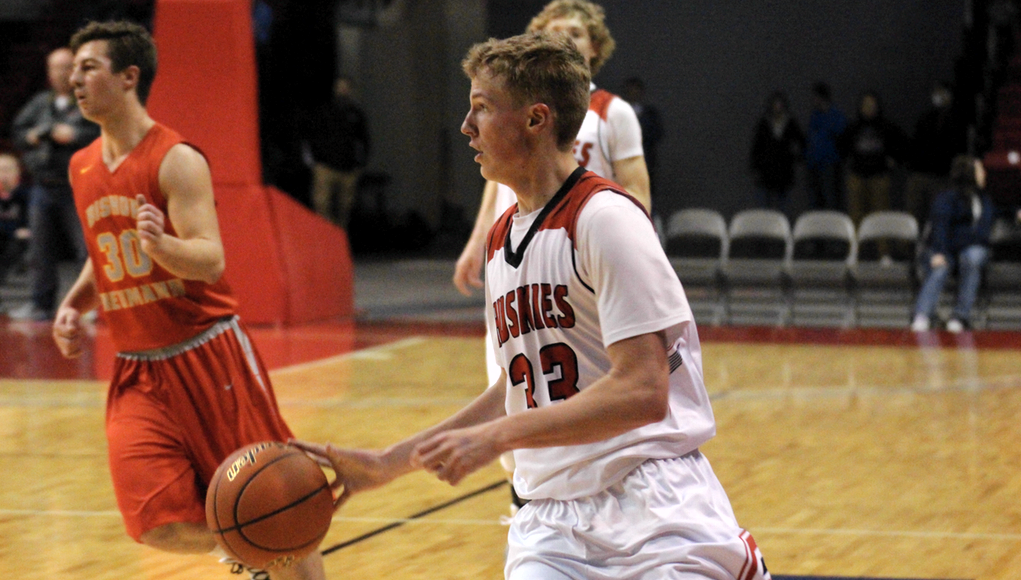 Aurora's Henry Penner brings the ball up the floor against Bishop Neumann during the 2016 Heartland Hoops Classic.