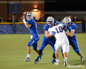 Kearney quarterback Kanon Koster fires a pass (or runs the ball) in the Bearcats win 17-0 over Grand Island on Friday. Koster finished 7-for-17 for 111 yards passing and also added 18 carries for 78 yards. Photo Courtesy of @BearcatPics.