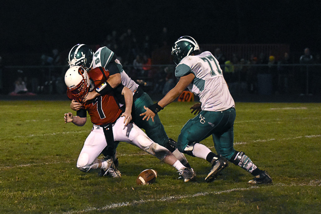 Riley Homolka (64) and Zack Keller (77) force a fumble of Yutan's Jerrad O'Malley in the semifinals.